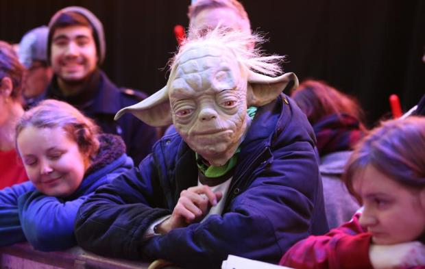 Enthusiasts, one wearing a Yoda costume, wait to spot members of the cast at the European Premiere of Star Wars, The Force Awakens in Leicester Square, London