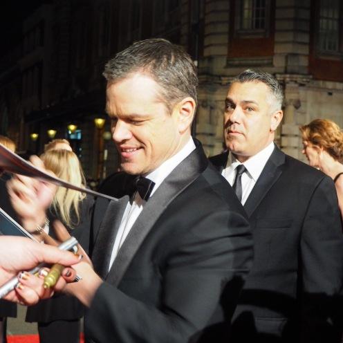 Matt Damon signing on the #EEBAFTAs Red Carpet 2016 taken on an Olympus OMD EM10