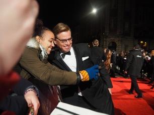Aaron Sorkin taking a photo with a fan on the #EEBAFTAs Red Carpet 2016 taken on an Olympus OMD EM10