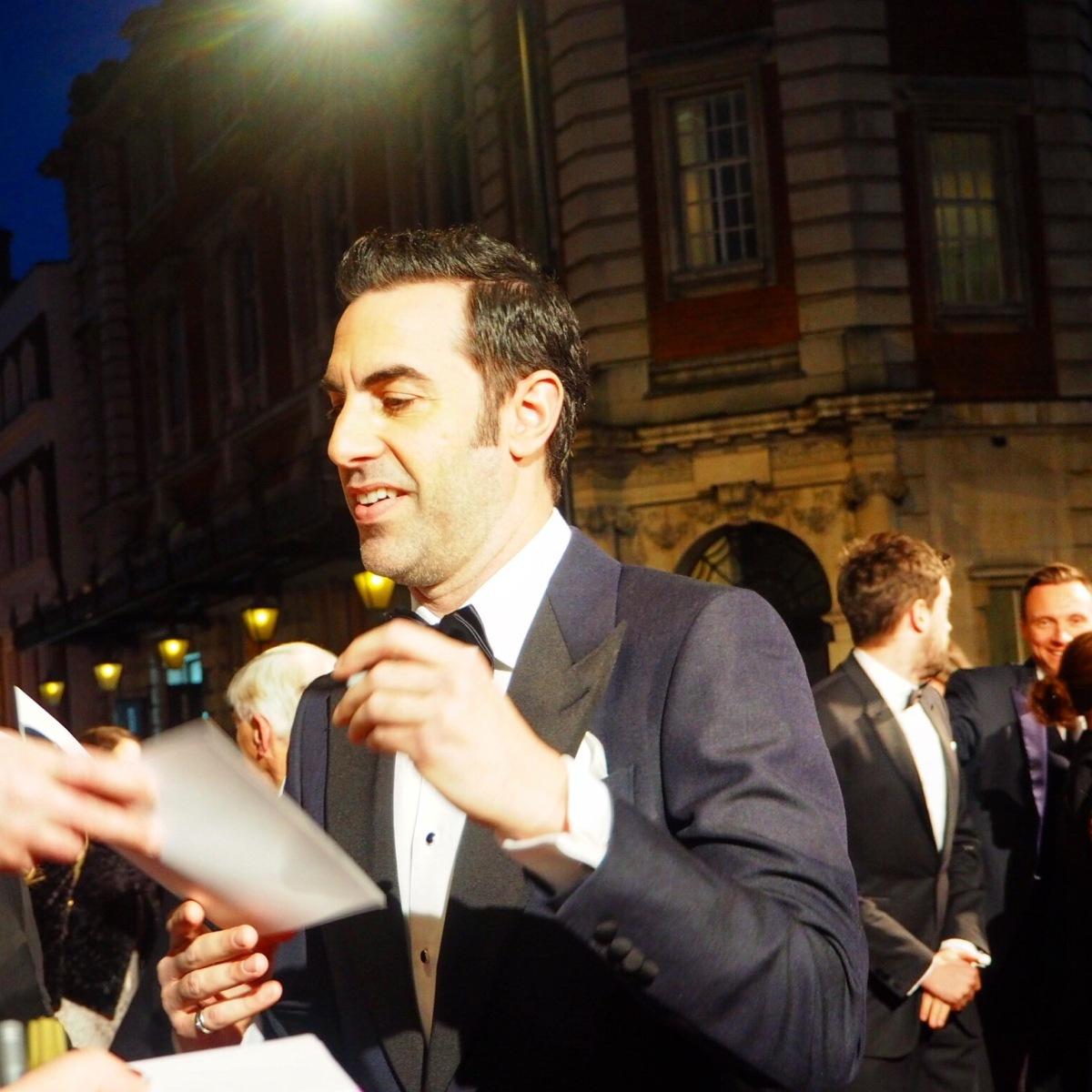 Sacha Baron Cohen signing on the #EEBAFTAs Red Carpet 2016 taken on an Olympus OMD EM10